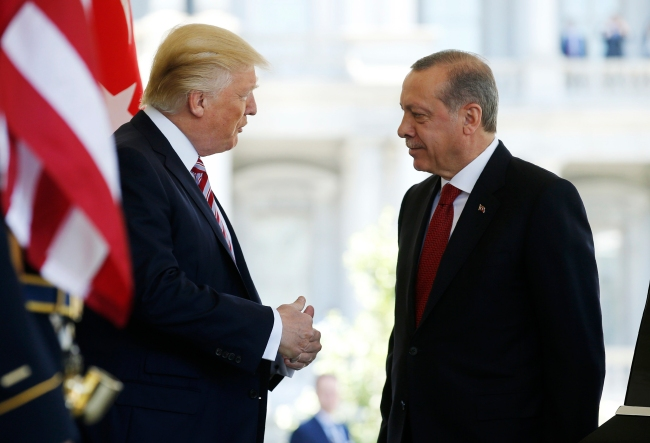 Image: President Trump talks with Turkey's President Erdogan at the entrance to the West Wing of the White House in Washington